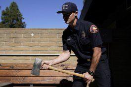 bomberos rescataron a woods con hacha y celeridad
