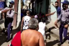un policia cubano golpea y patea a una mujer en la habana entre gritos de abusador y descarado
